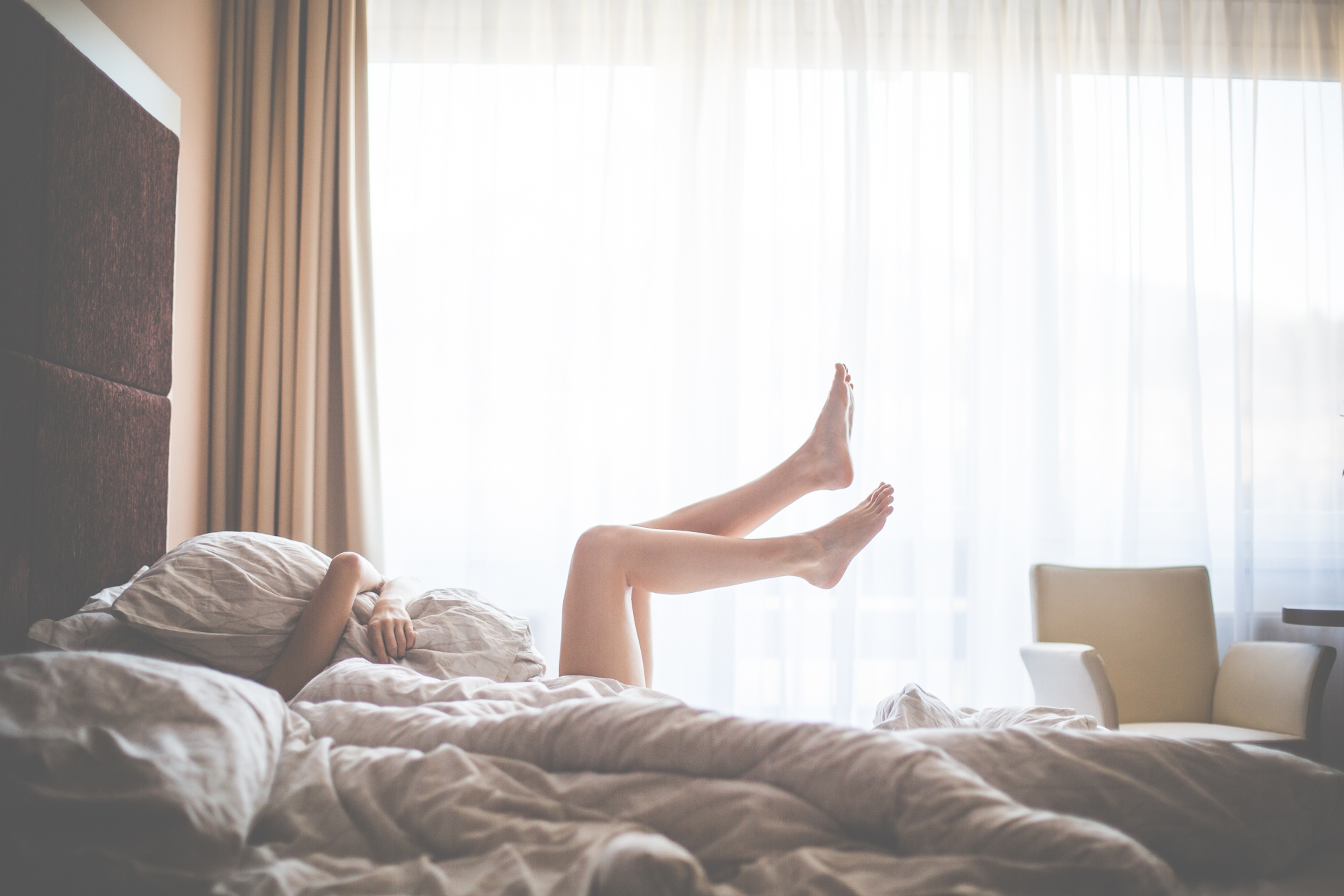 beautiful-woman-enjoying-morning-relax-in-bed-picjumbo-com